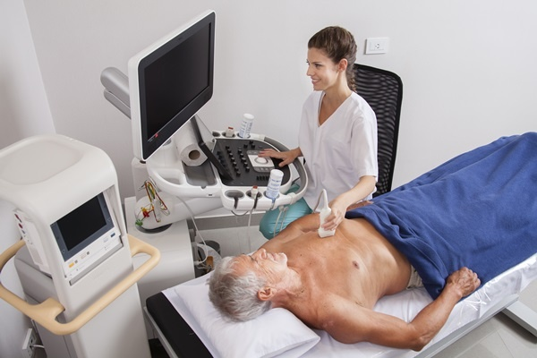 Happy woman doctor analyzing  patient with ultrasound stock image heart exame